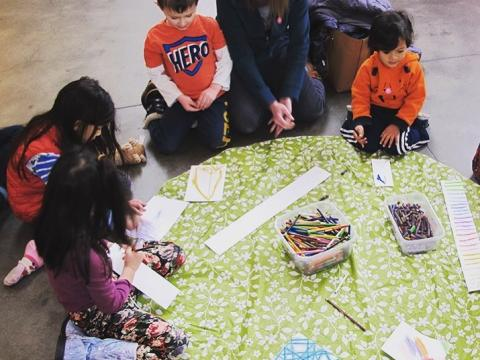 Children and parent making crafts