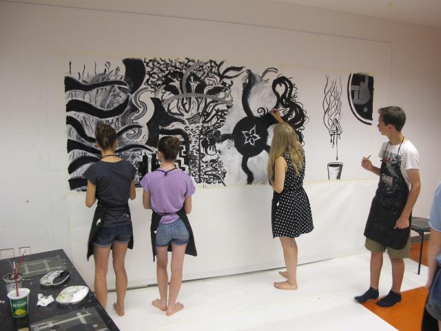 Teens painting a mural