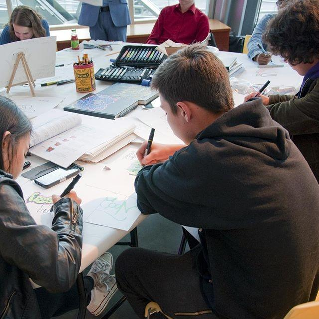 Teens drawing at table