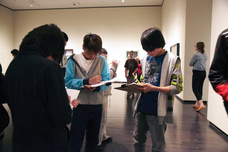 teens drawing in a gallery